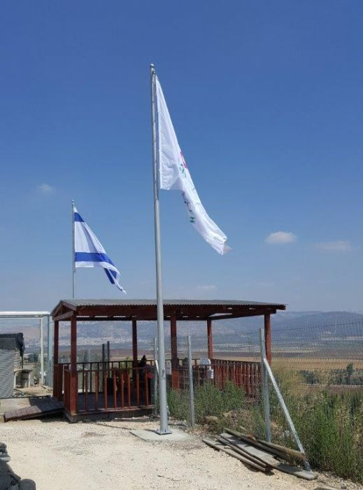 Installation תורן 25-foot-tall Connie steel flagpole at The A.T. Alon Tabor Company with a flag of 2.6 by 3.6 meters from ramming fabric