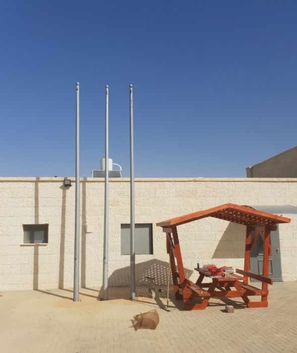 Installing a 20-foot connie steel flagpole at Yeruham fire station תורן