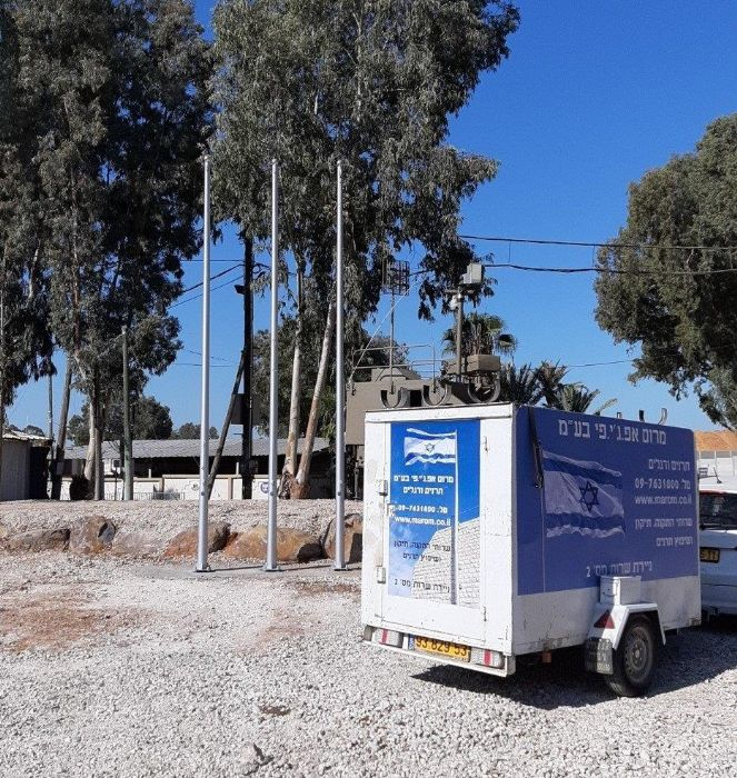 Installing a 20-foot-tall Connie steel mast at the base of Tel Hashomer תורן