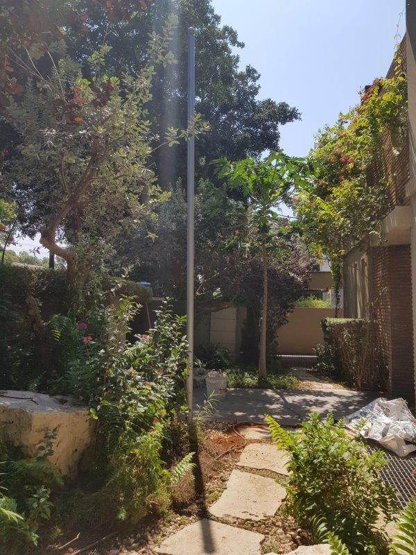 Flagpole mast with diameter 3 tsal height 5 meters installation at The Peruvian Ambassador's House in Herzliya Development